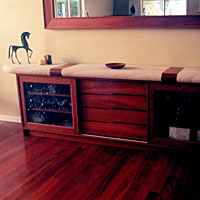 Low Jarrah Buffet Featuring Handleless Drawer Pulls, Sliding Doors and Sandstone Top.